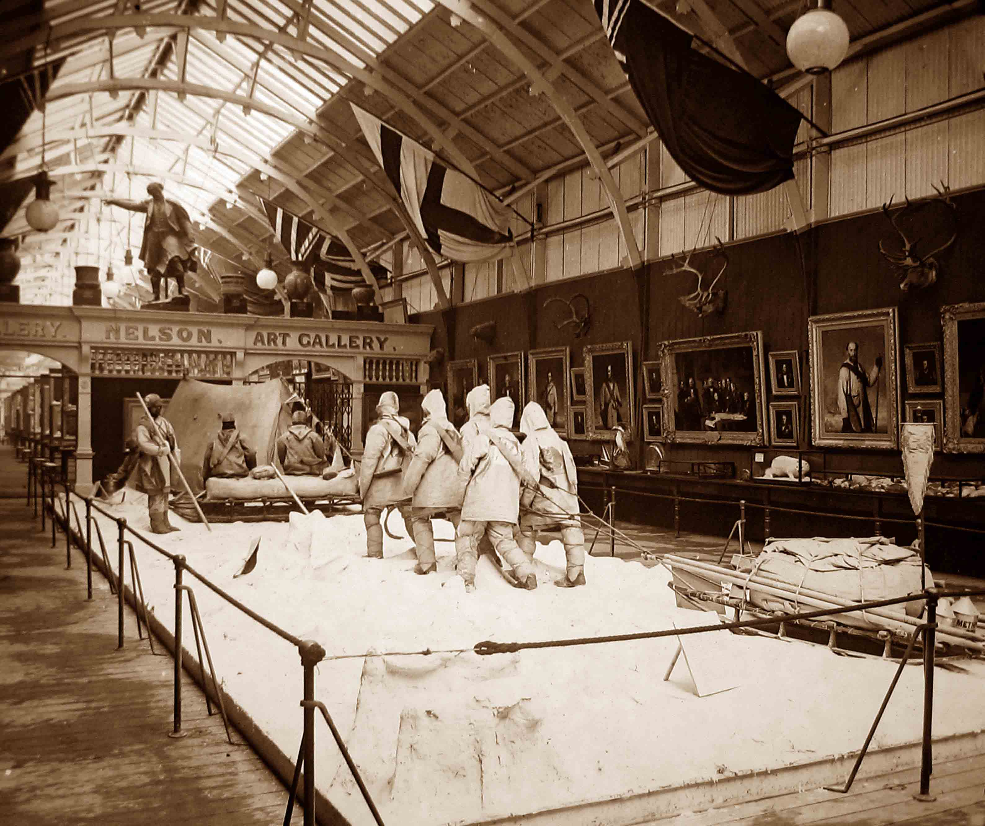 An arctic tableau display at the Royal Naval Exhibition of 1891. Arctic explorers pull a sled by hand with ropes.