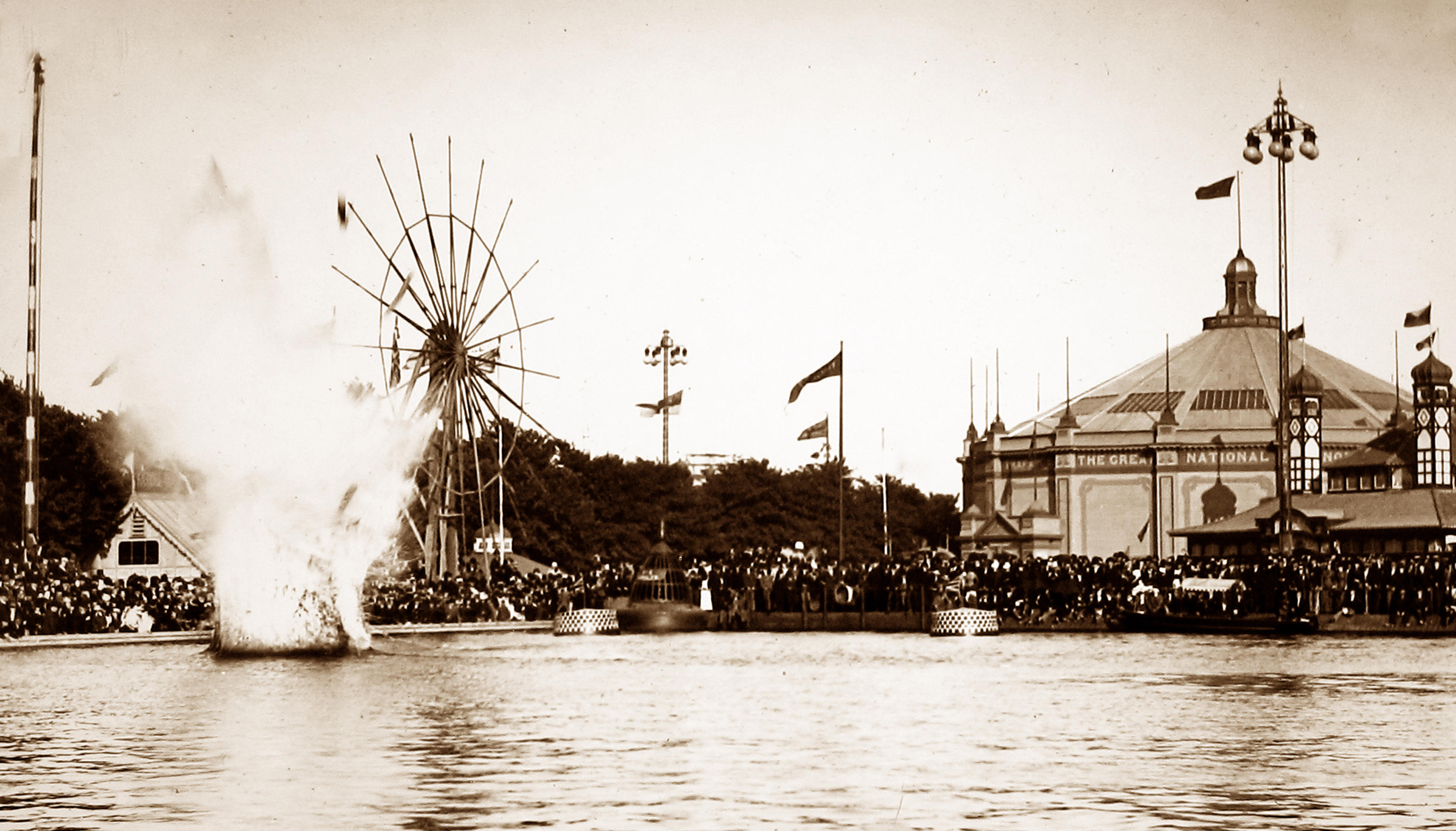 1891 - Whitehead torpedo demonstration. An explosion on the water demonstrating torpedos to stands of onlookers.