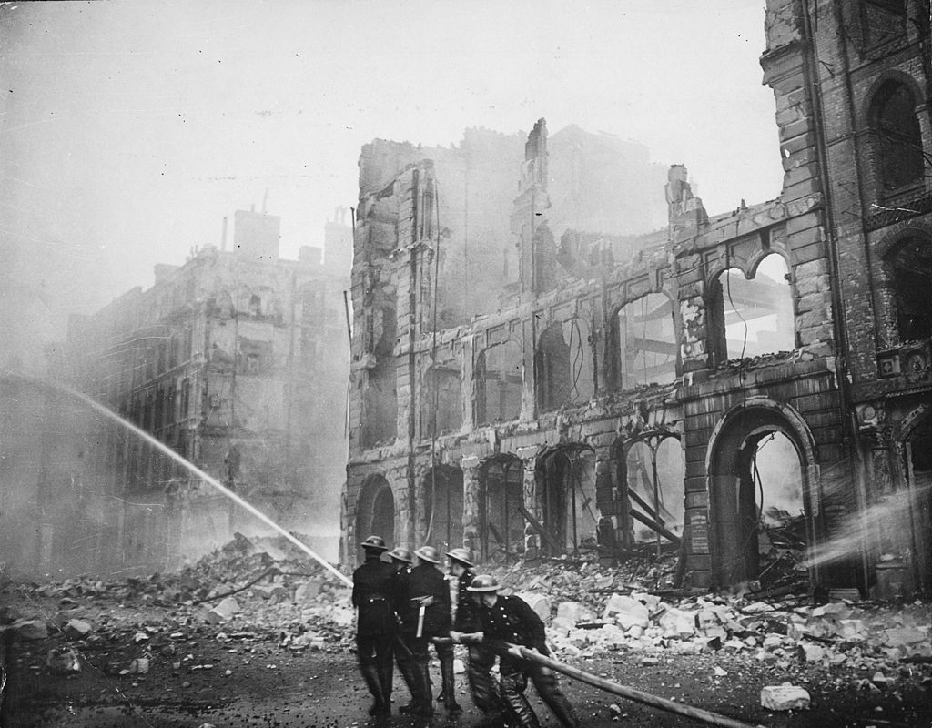 Firefighters amidst rubble in London during the Blitz