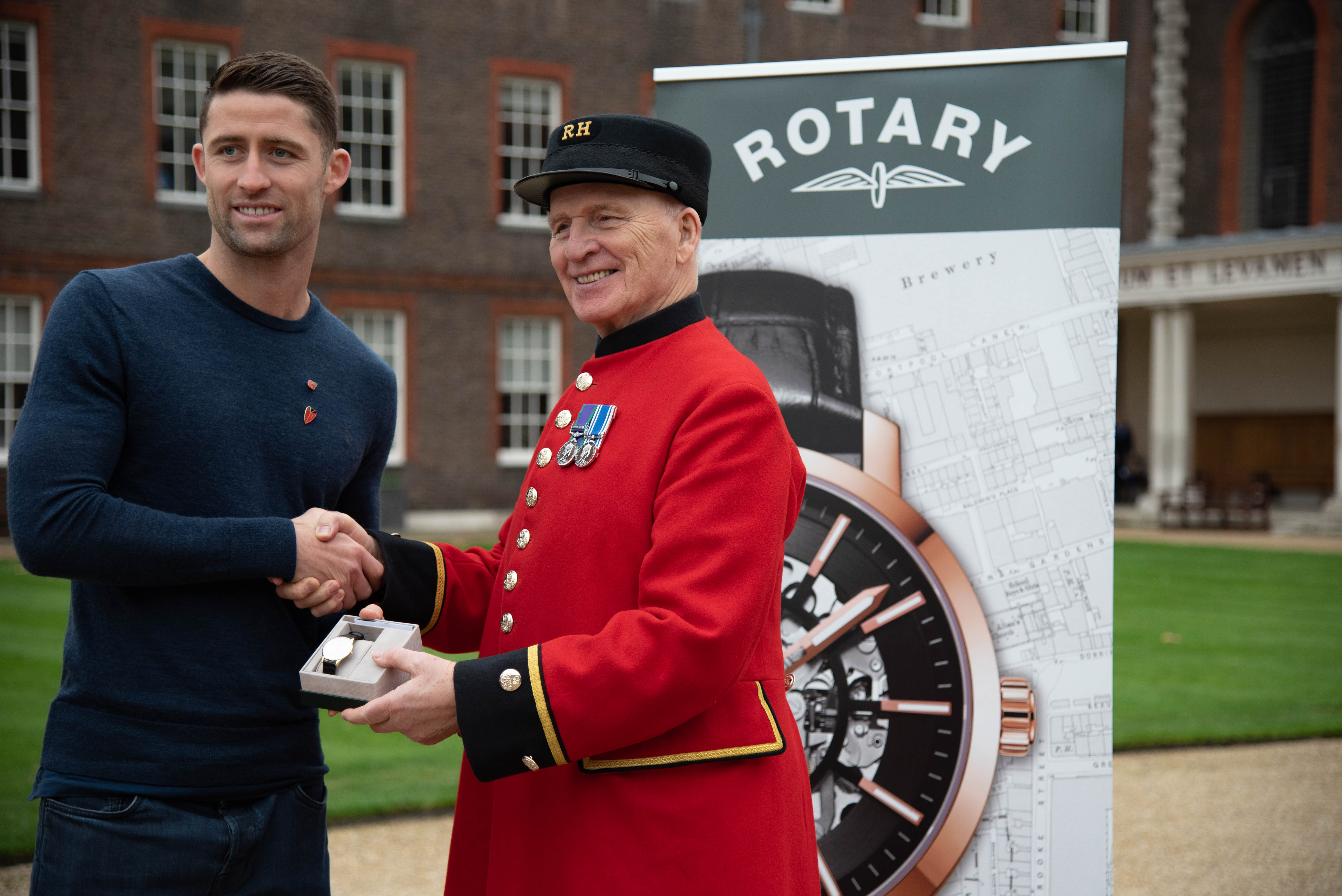 Gary presenting Rotary watch to Chelsea Pensioner