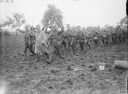 Men of the Wiltshire Regiment in which Steve's grandfather served, returning after battle wearing captured German uniforms