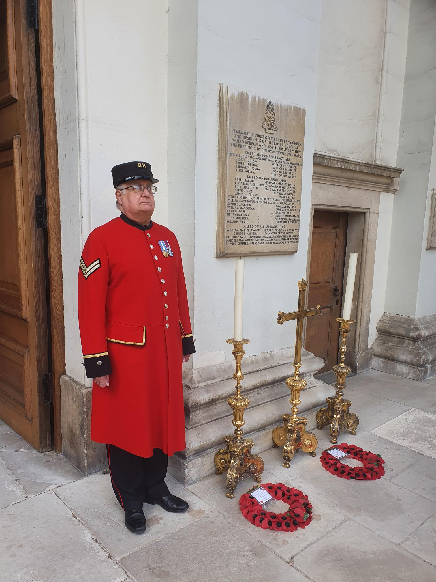 A Pensioner besides wreaths laid on the 80th anniversary at the Royal Hospital