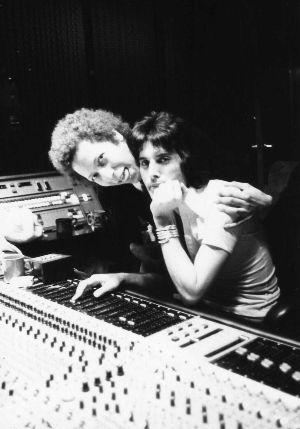 Peter Straker and Freddie Mercury in a music studio