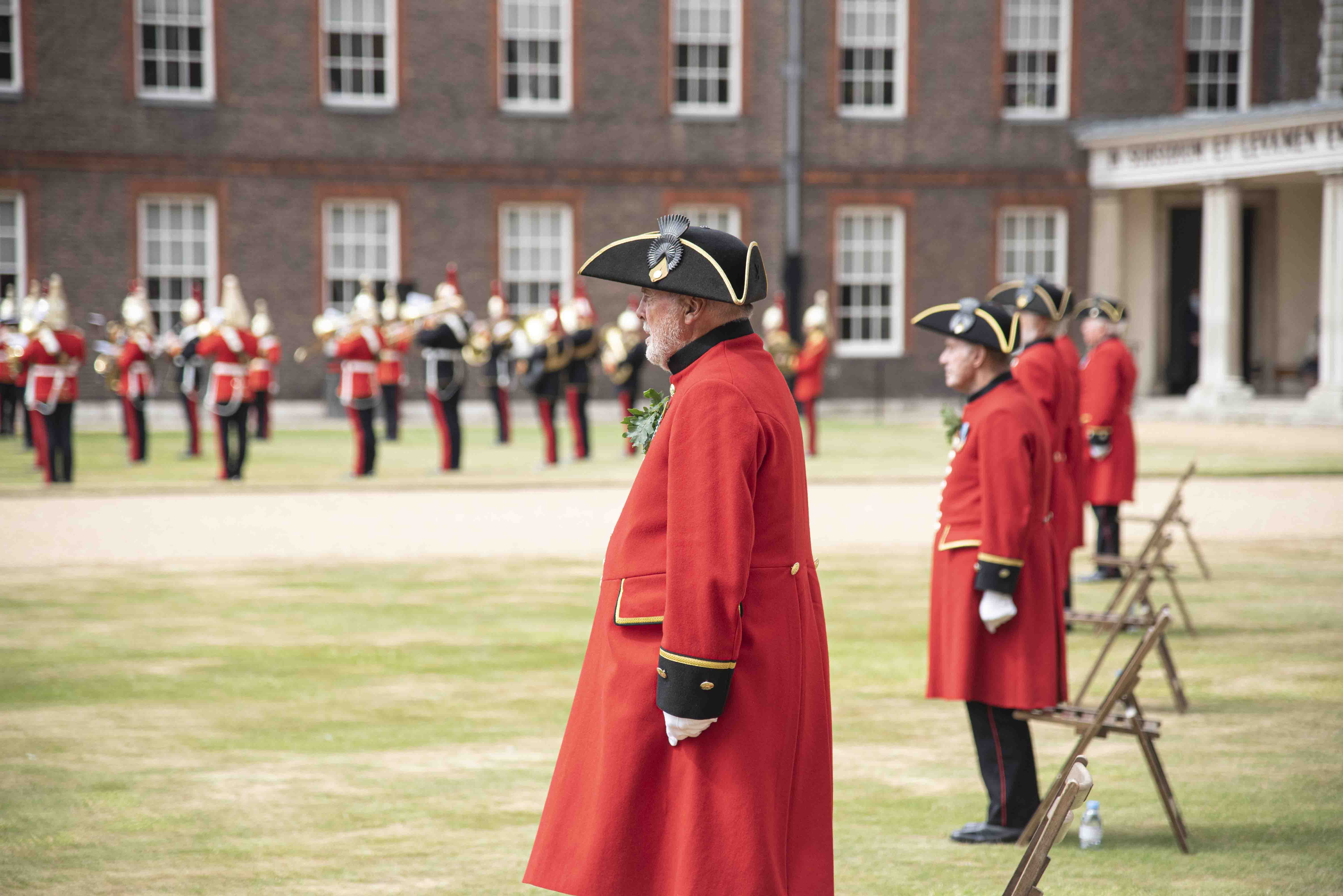 A Pensioner on parade at Founder's Day 2020 with the Household Cavalry band in the background