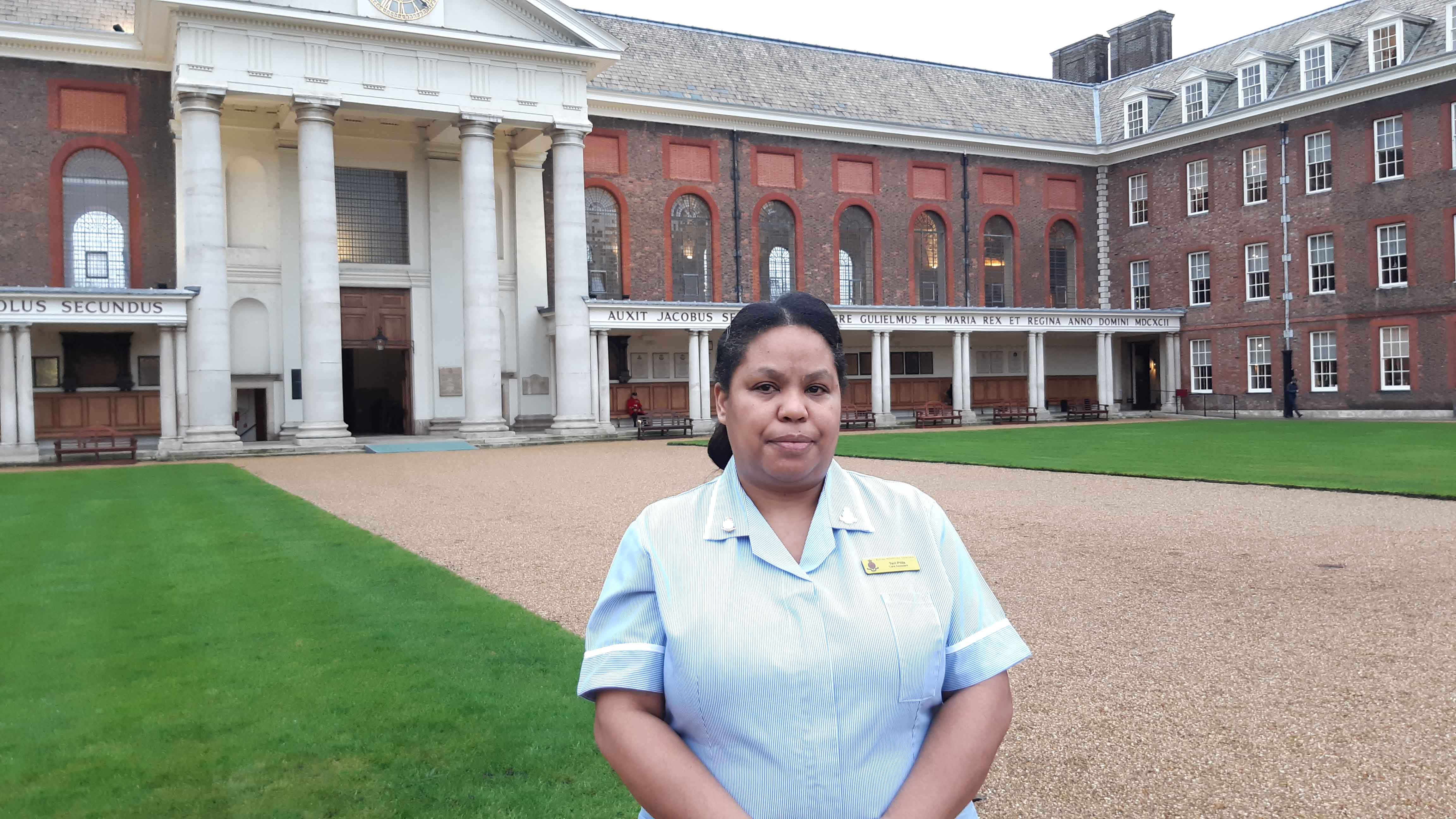 Care Assistant Terri standing in Figure Court at the Royal Hospital Chelsea