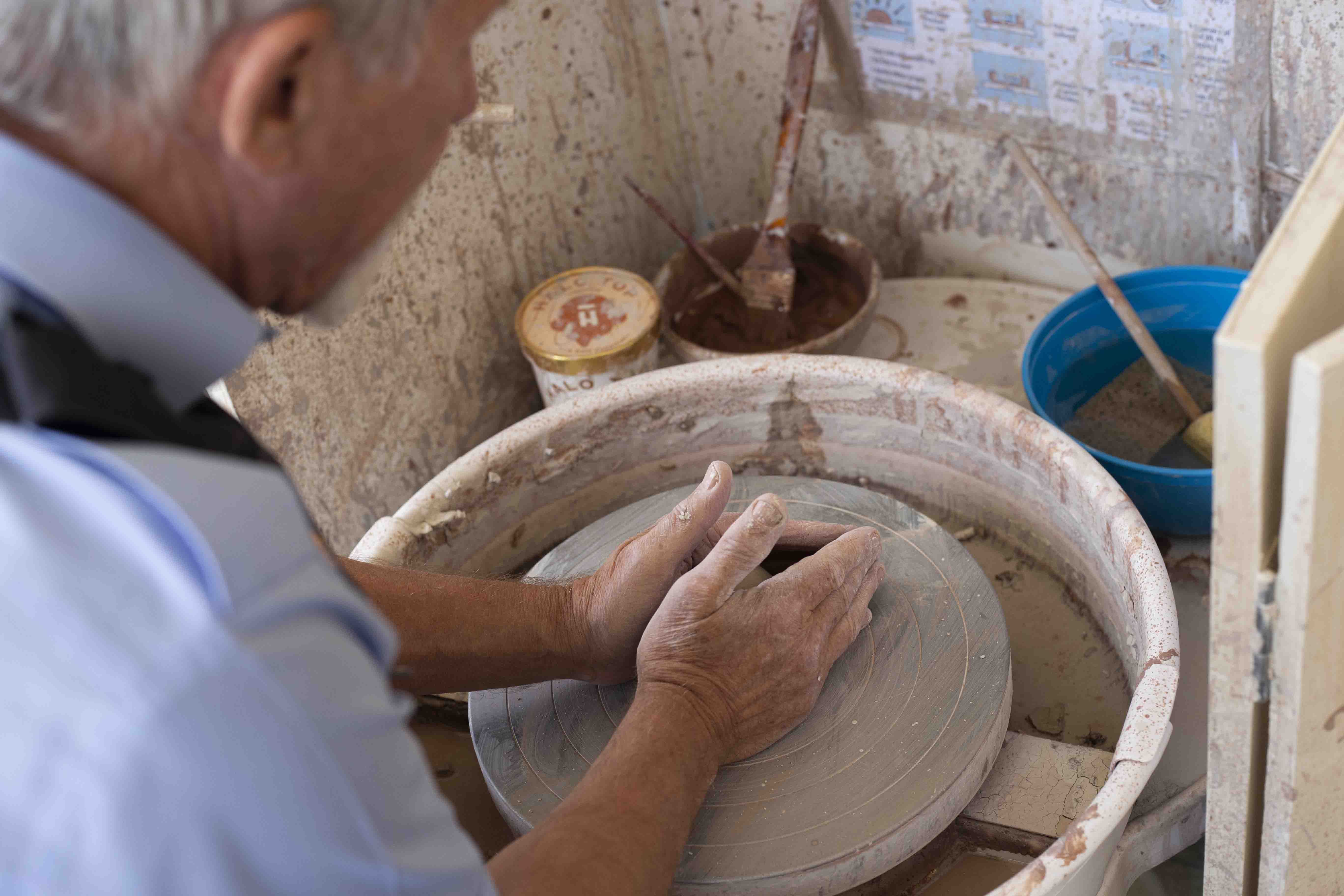 A Chelsea Pensioner making pottery