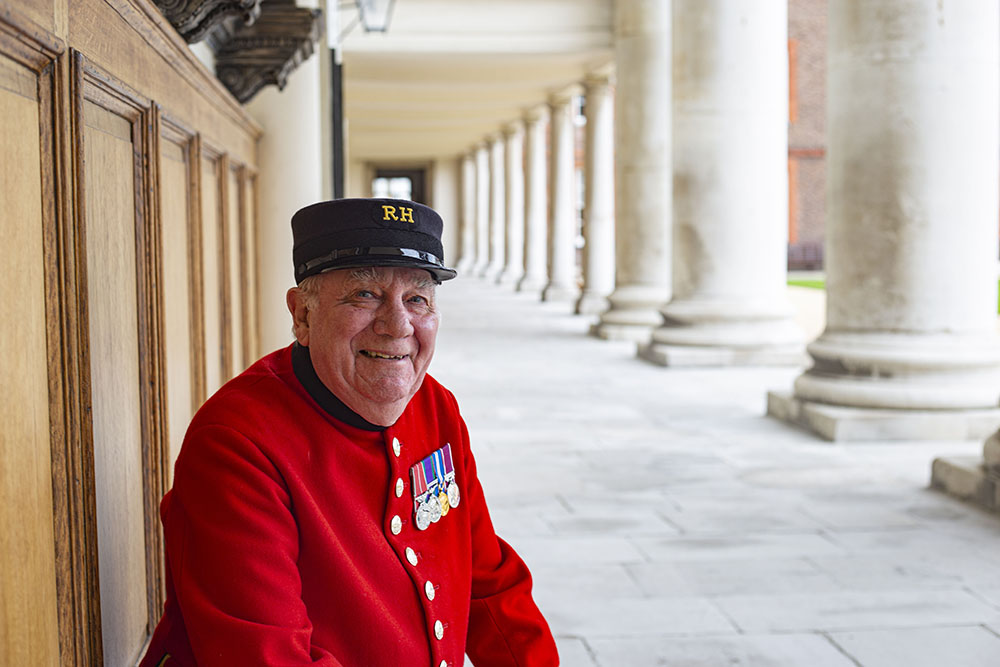 Pensioner Leo Tighe sitting on a bench on the Royal Hospital's collenade
