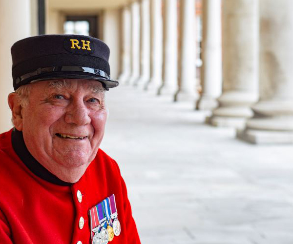 Pensioner Leo Tighe sitting on a bench on the Royal Hospital's colonnade