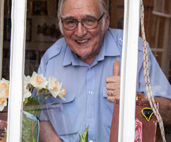 Pensioner Ray Pearson gives thumbs up from berth window