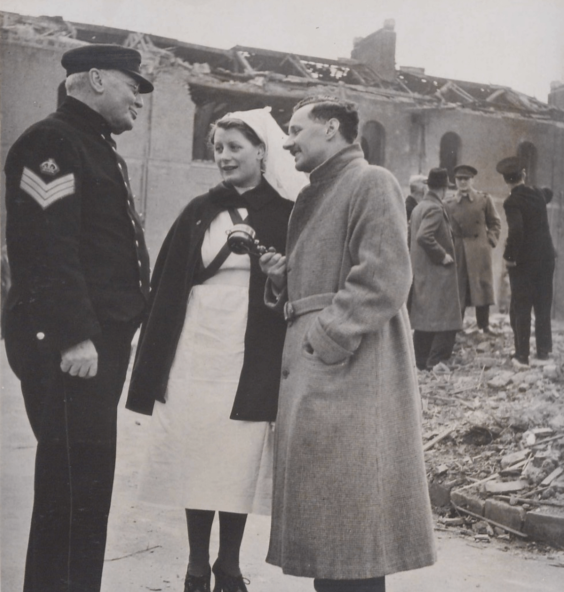 Journalist Vaughan-Thomas, Pensioner J. J. Jones and a nurse in the aftermath of the bombing