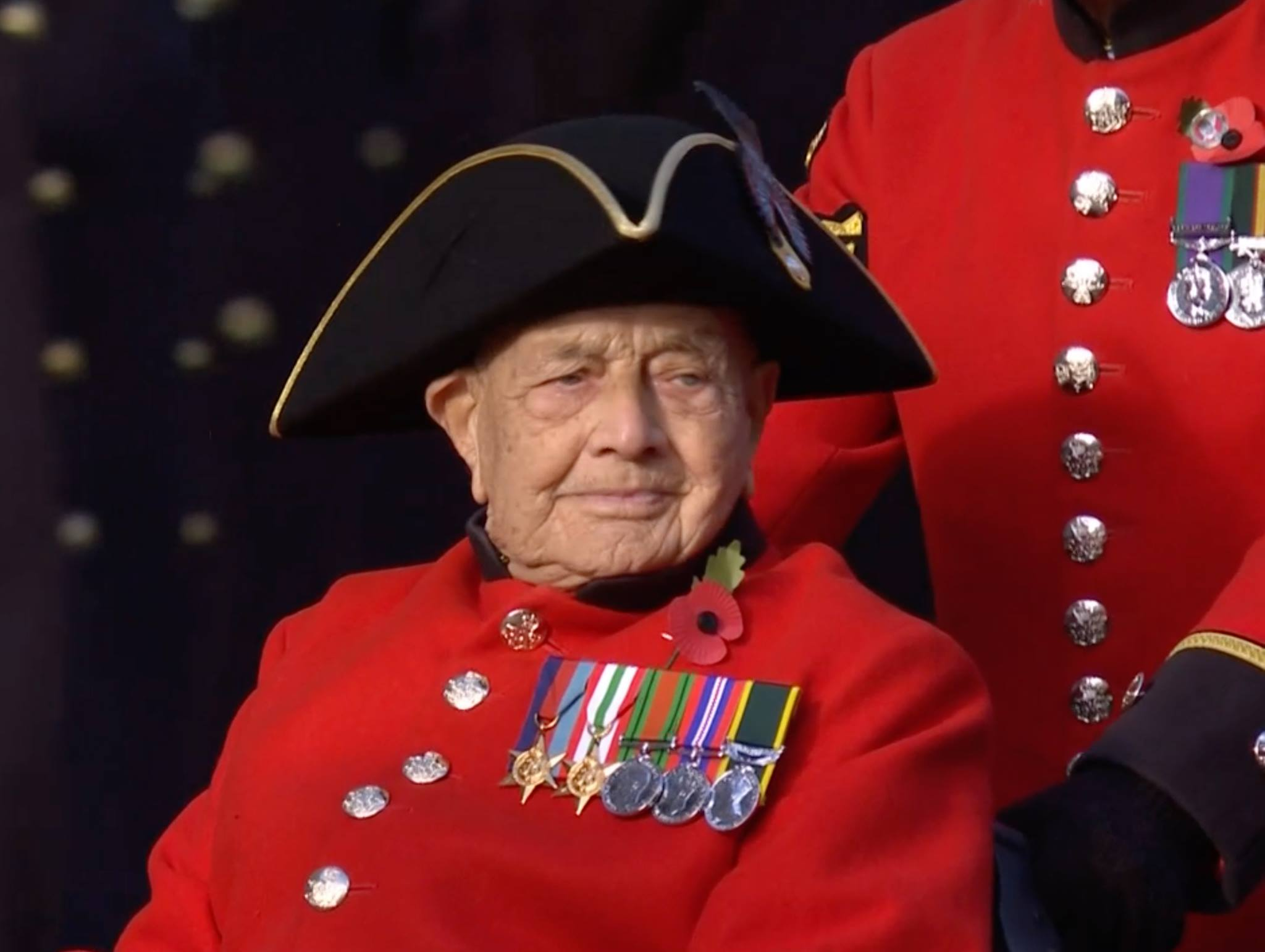 Chelsea Pensioners march past the Cenotaph