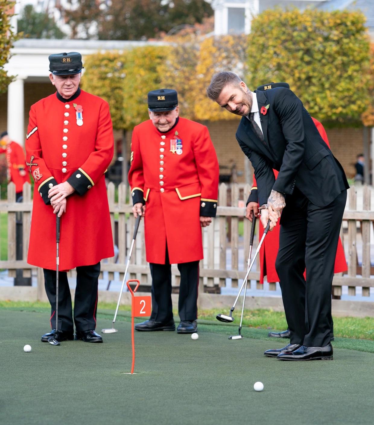 David Beckham shows off his putting skills