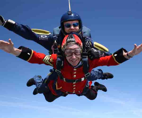 Pensioner Charmaine Coleman skydiving tandem in Scarlets