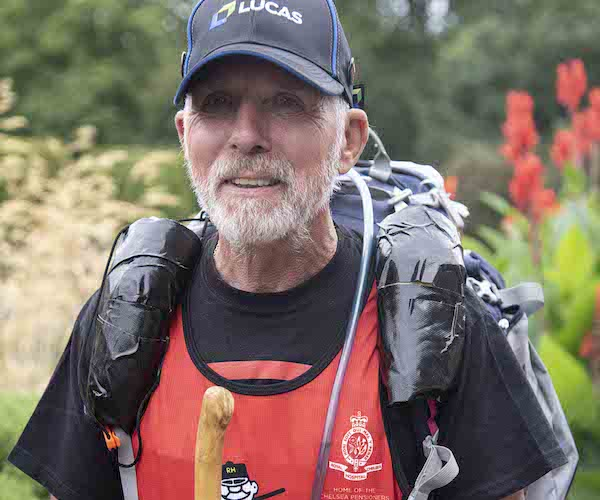 Pensioner Alan Rutter with walking stick and backpack at Royal Hospital