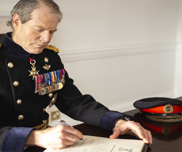 Governor, General Sir Adrian Bradshaw signing the Armed Forces Covenant