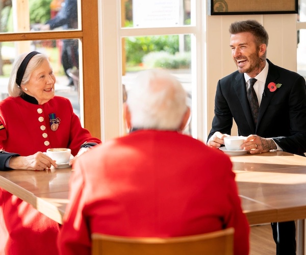 David Beckham joins the Chelsea Pensioners for tea.
