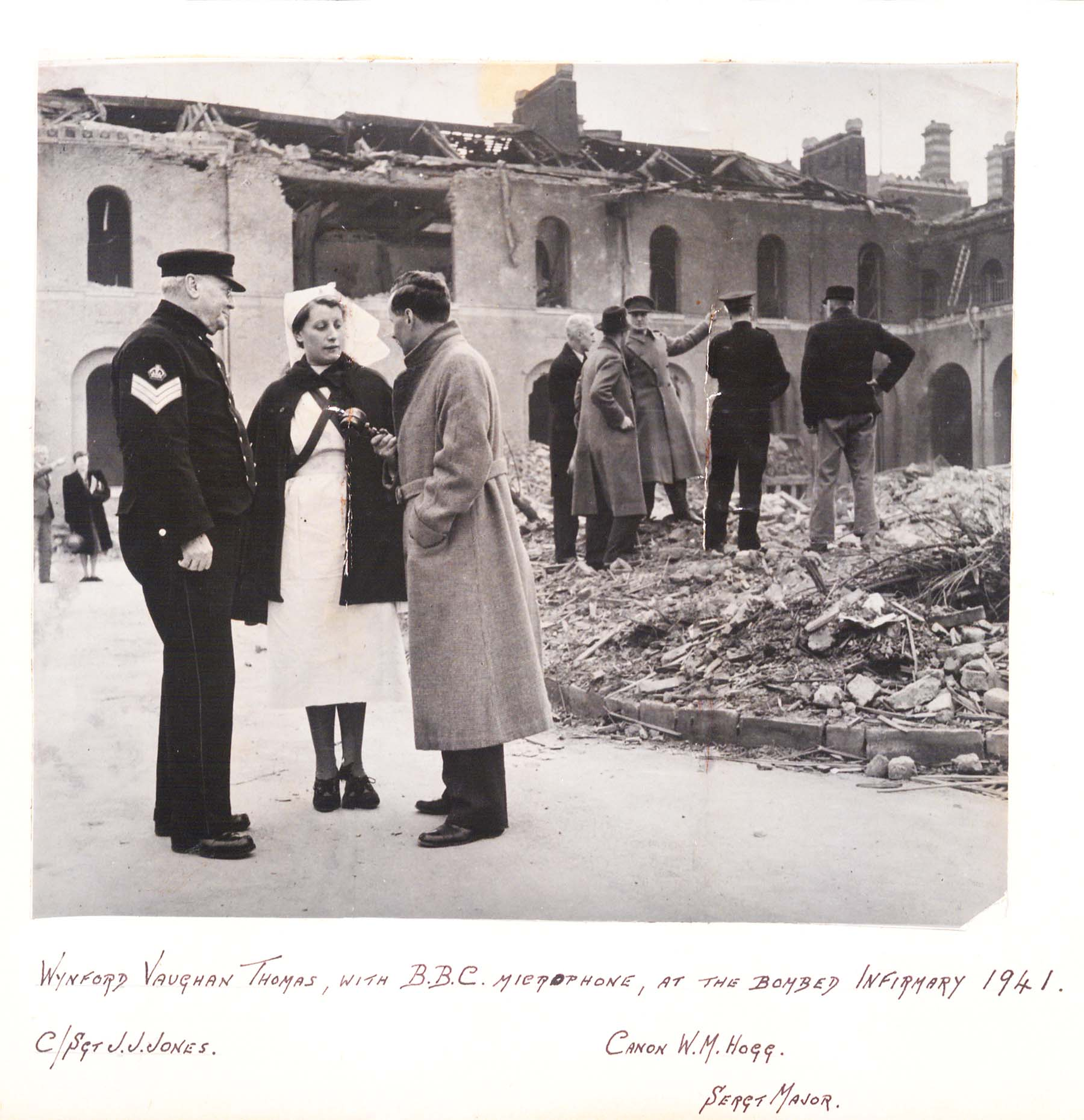 A nurse and the Royal Hospital's Chaplain, Cannon Hogg, talk to a BBC reporter in the aftermath of the bomb.