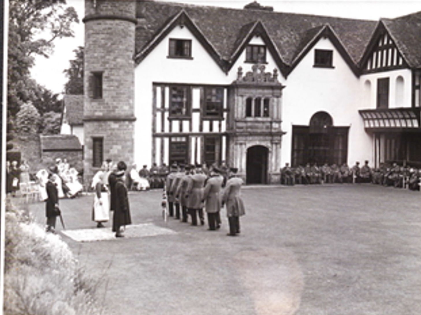 A nursing sister and five nurses watch the Founder's Day parade at Rudhall Manor in 1940