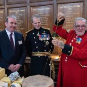 Chelsea Pensioner pictured Dairy UK Chair Paul Vernon, the Governor of the Royal Hospital and the ceremonial cheese