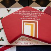 This year's cake shaped in the Adelaide logo